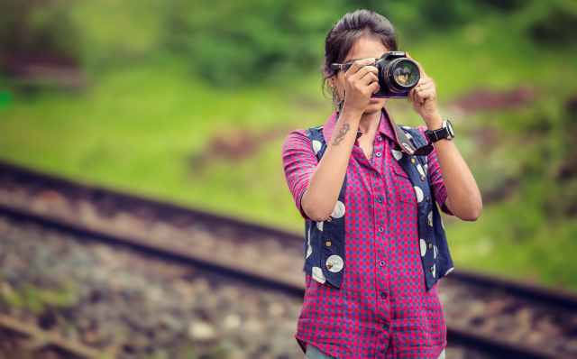 A photo of a female who took a picture outdoors.