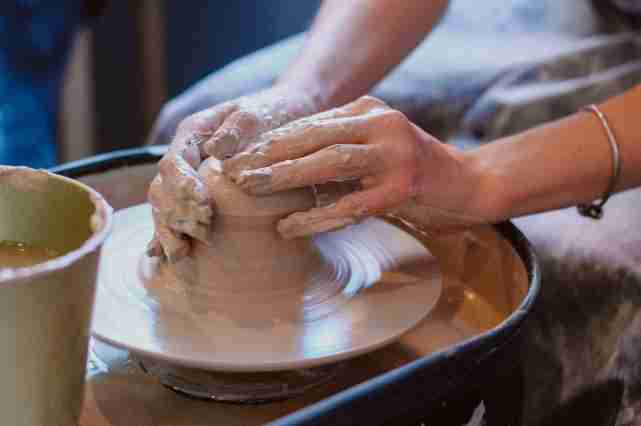 A potter throwing clay.